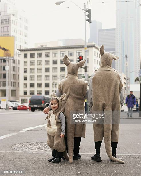 Family wearing kangaroo costumes, downtown Seattle, USA
