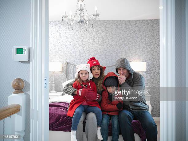 Family wearing winter clothing in bedroom of energy efficient house