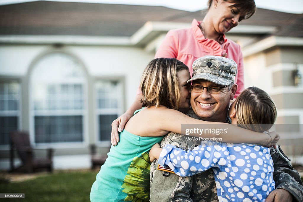 family welcoming army father : Stock Photo