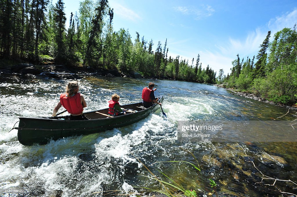 Family white water paddling