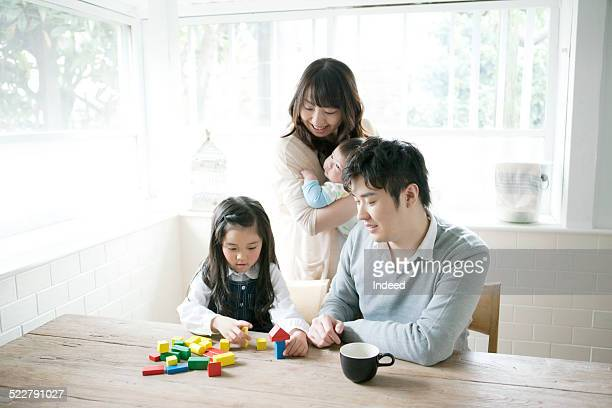 A family who play with building blocks
