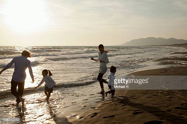 Family who plays in beach in evening