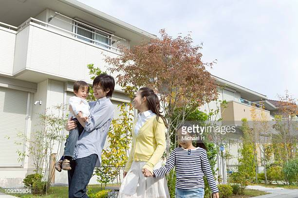 Family who strolls happily