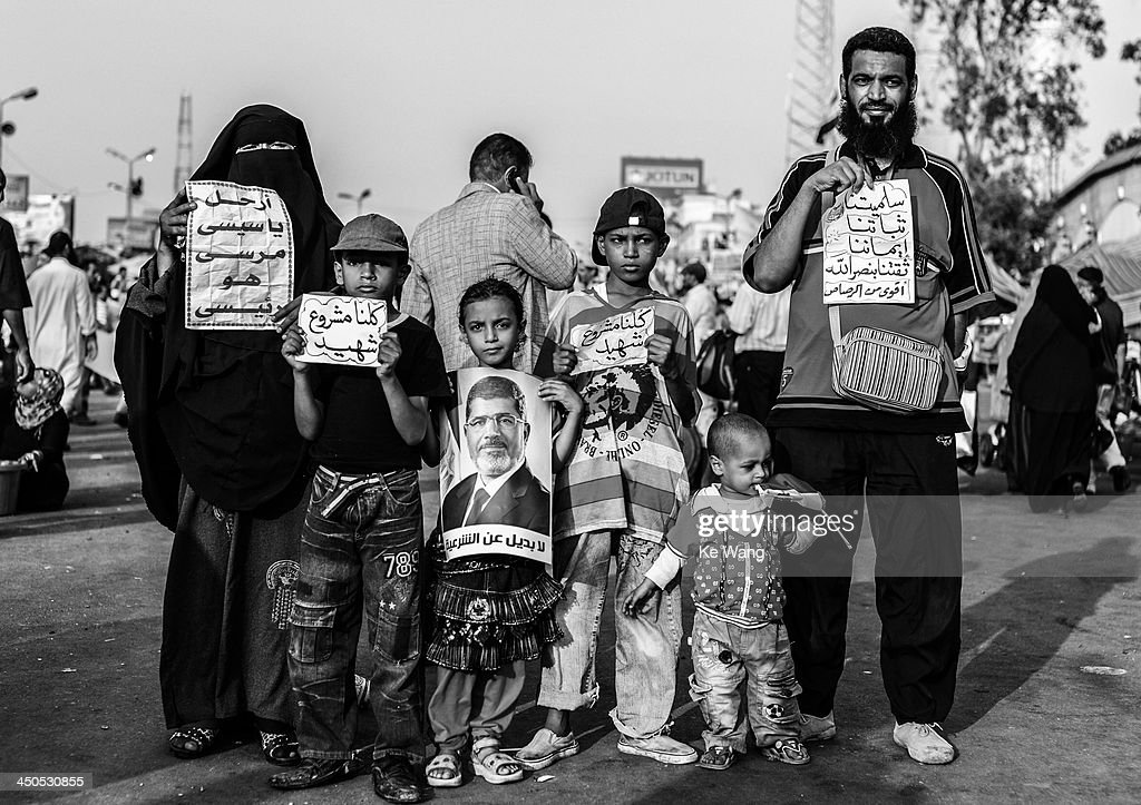 CONTENT] A family who support Egypt's ousted president Mohamed Morsi pose for a picture at Rabia AlAdawiya Mosque in Cairo Egypt July 9 2013