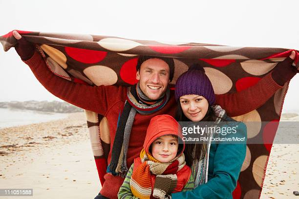 Family with a blanket on the beach
