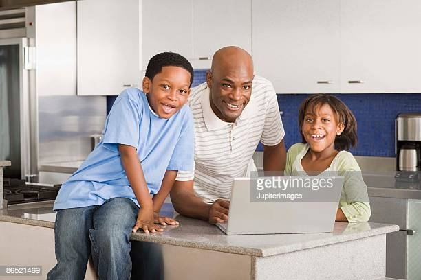 Family with a laptop computer
