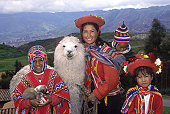 Family with alpaca, parrot and puppy, Cusco, Peru