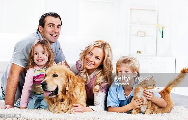 Family with animals sitting on the carpet