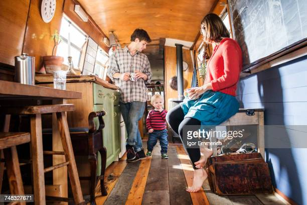 Family with baby boy living on barge