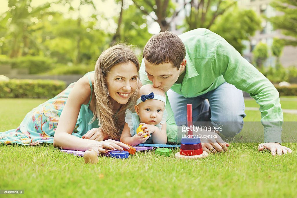 Family with baby in park : Stock Photo