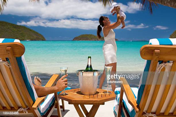 family with baby on a tropical Caribbean beach vacation