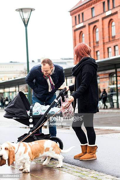 Family with Basset Hound on sidewalk
