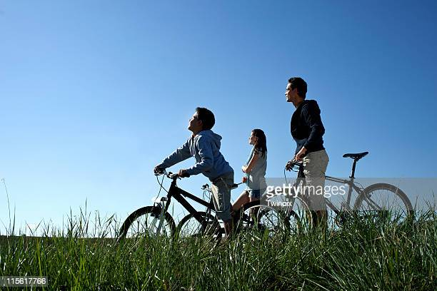 Family with bicycles resting in the sun