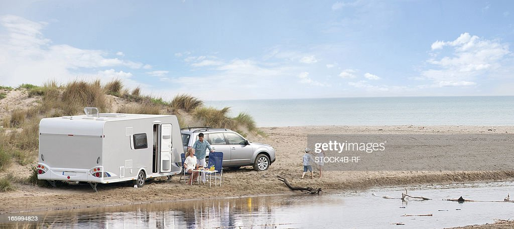 Brilliant Retro Caravan On The Beach And Sea Summer Holiday Stock Photo  Image