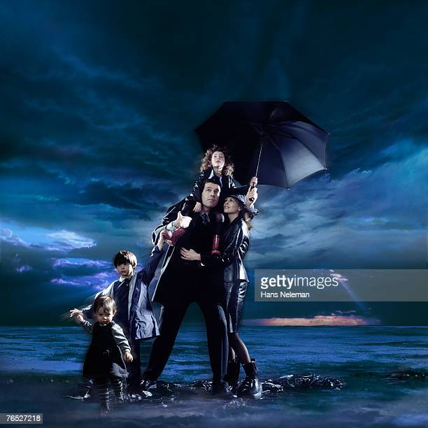 Family with children with cloudscape in background