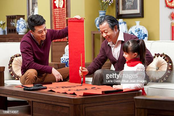 Family with Chinese calligraphy during Chinese New Year