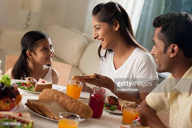 Family with daughter (6-7) having breakfast