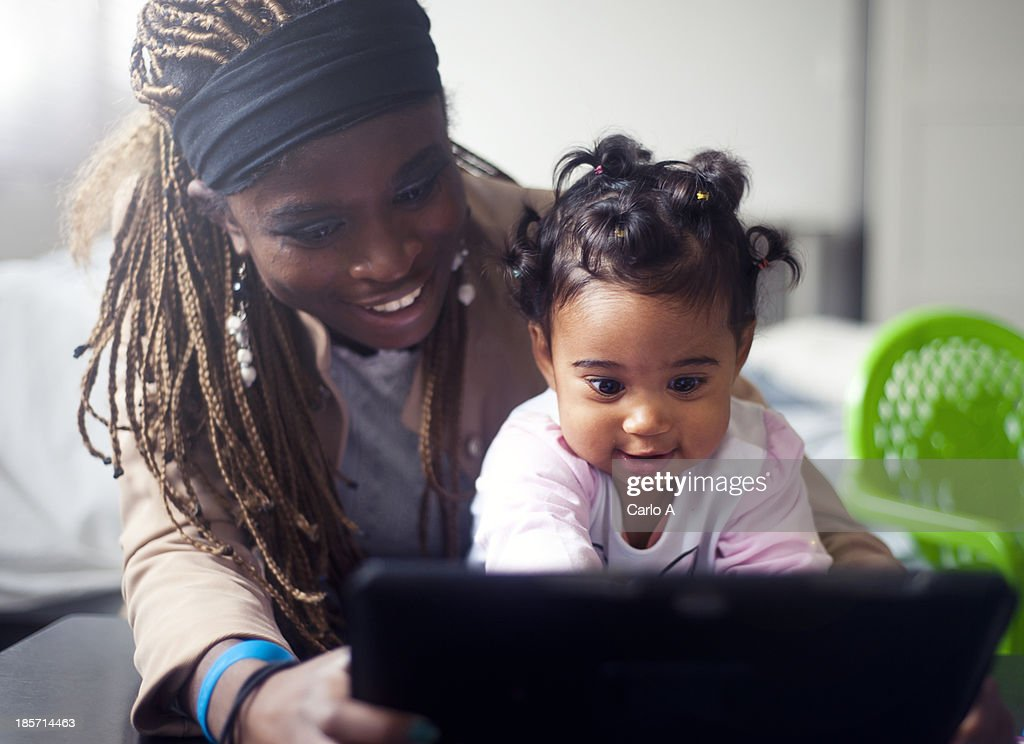 Family with digital tablet : Stock Photo