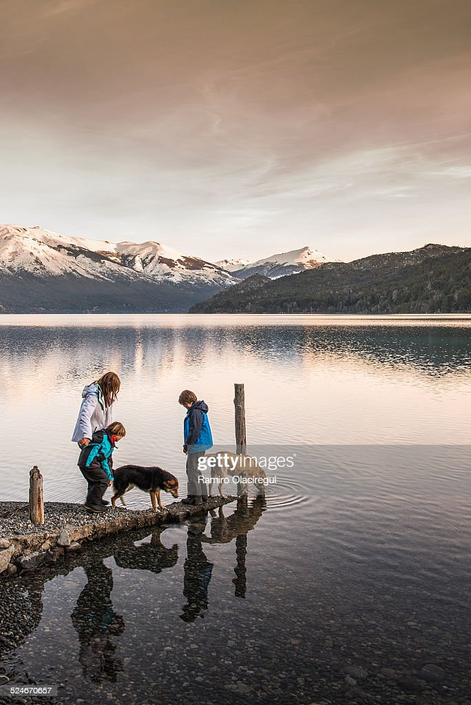 Family with dog on a lake