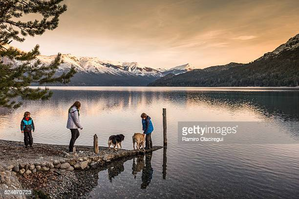 Family with dogs on a lake