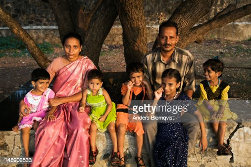 Family With Five Children Enjoying Sunset By The Ocean ...