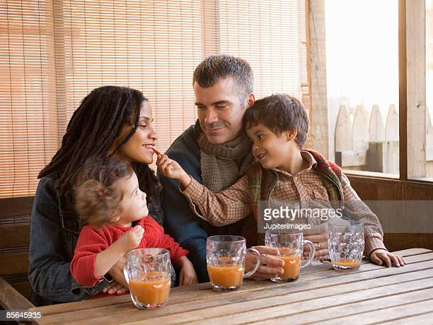 Family with hot apple cider