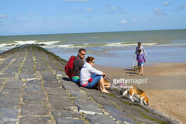 Family with hound at Belgian North Sea
