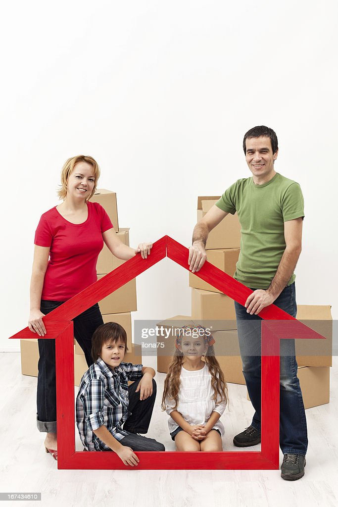Family with kids buying a new home : Stock Photo