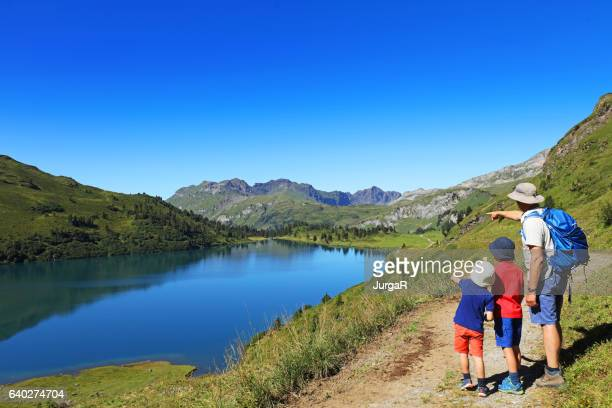 Family with Kids Hiking in the Swiss Mountains