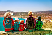 happy family with kids travel in Europe, Spain, looking at scenic view