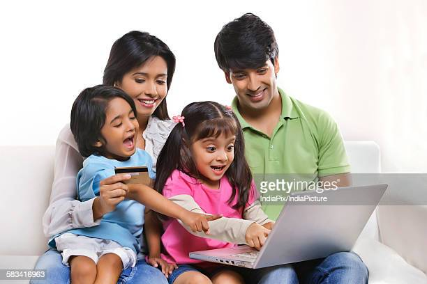 Family with laptop and credit card