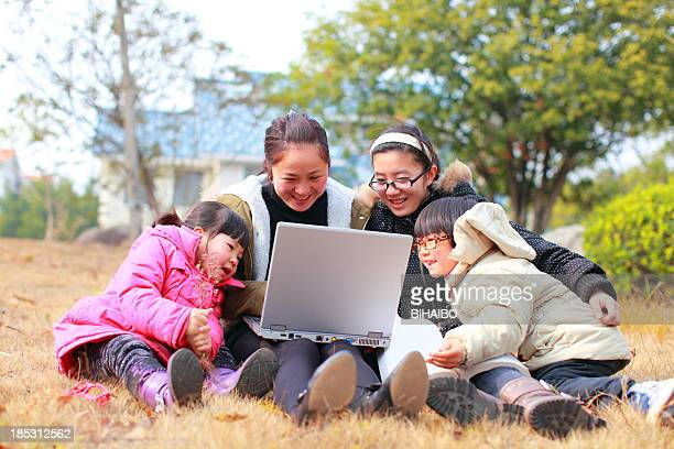 Family with laptops.