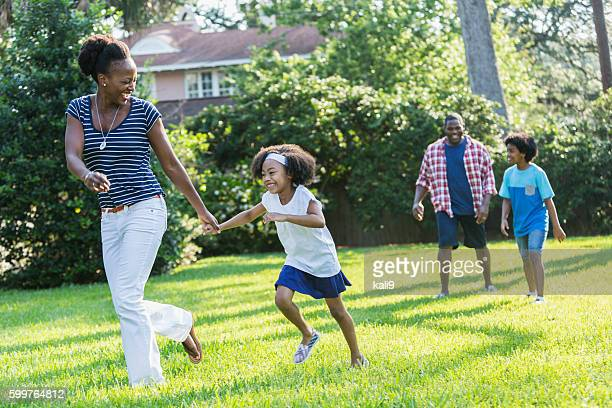 Family with mixed race children outdoor playing, walking