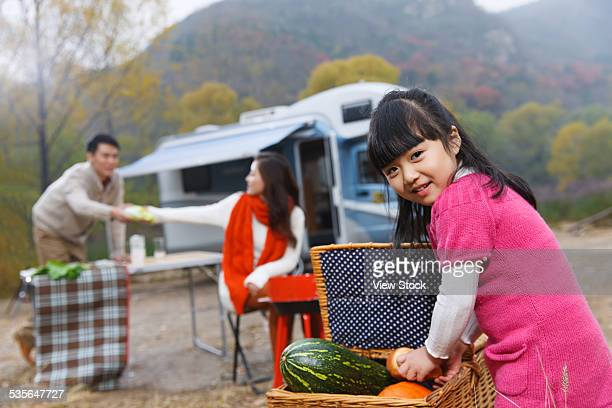 Family with one child camping