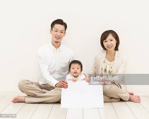Family With One Child Holding Placard
