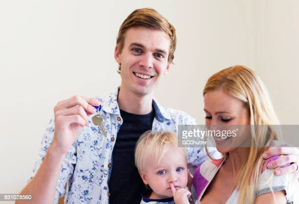 Family with one child smiling widely for their newly purchased home