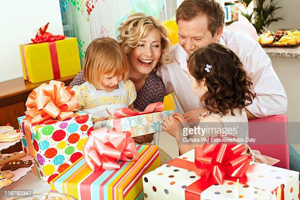 Family with presents at birthday party