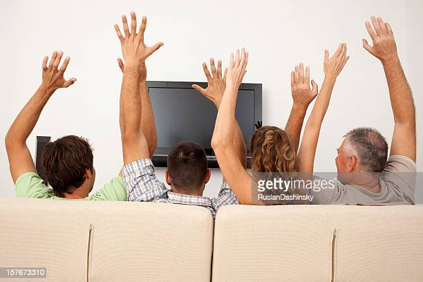 Family with raised hands.