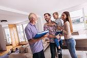 Family with real-estate agent visiting house for sale