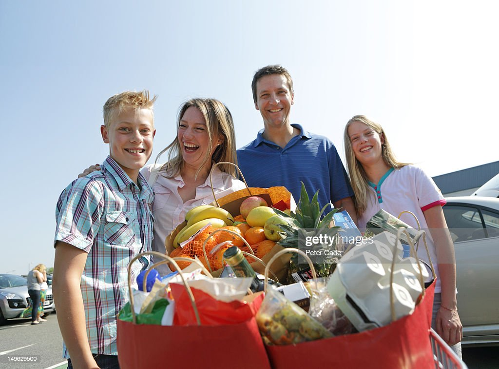 family with shopping in car park, happy : Stock Photo
