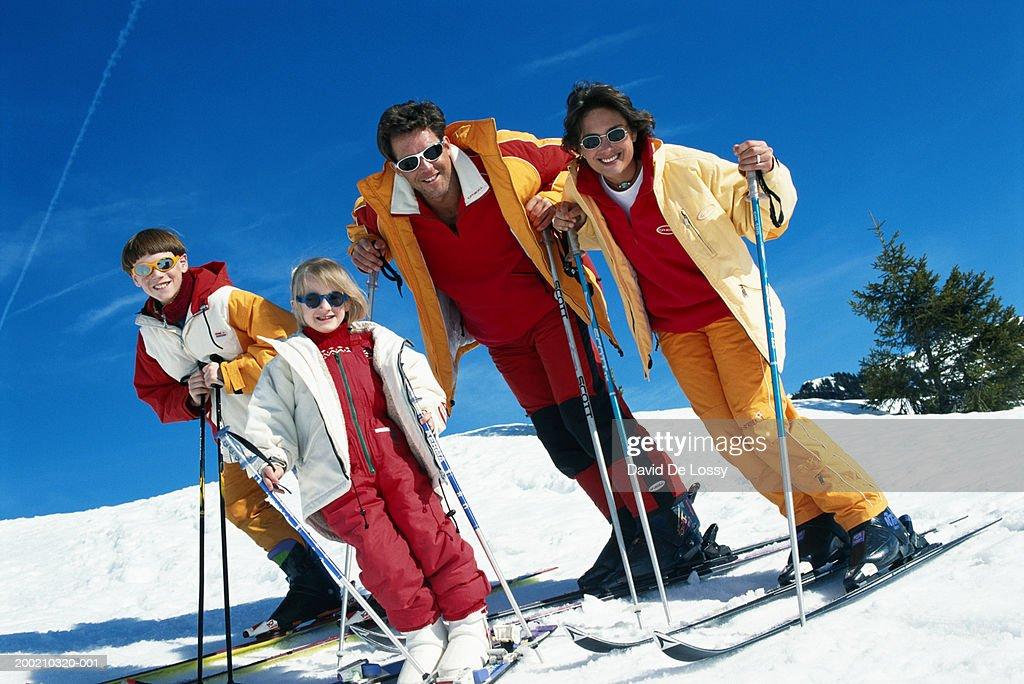 Family with ski pole : Stock Photo
