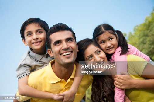 Family with son and daughter (6-7) in park