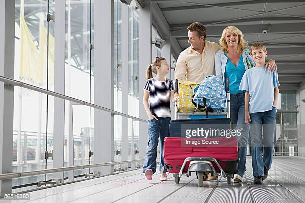 Family with suitcases in an airport