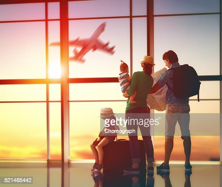 family with suitcases : Stock Photo