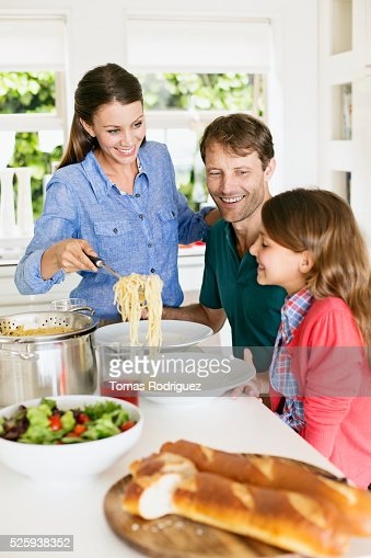 Family with teenage girl (13-15) eating spaghetti : Stock Photo
