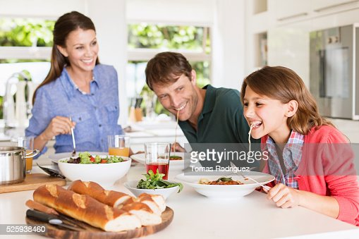 Family with teenage girl (13-15) eating spaghetti : Photo
