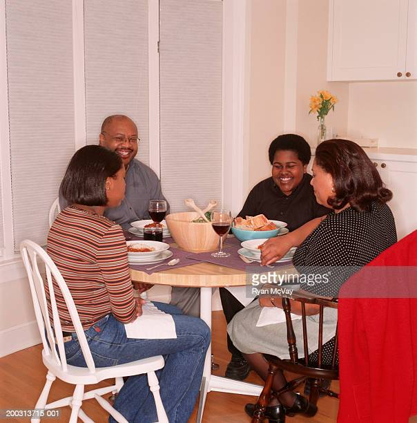 Family with teenage son and daughter (16-17), sitting at kitchen table, portrait, elevated view