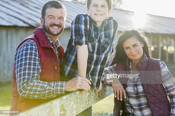 Family with teenage son on a farm