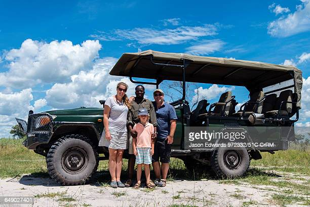 A family with their safari guide and 4wd