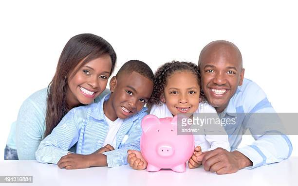 Family with their savings in a piggybank